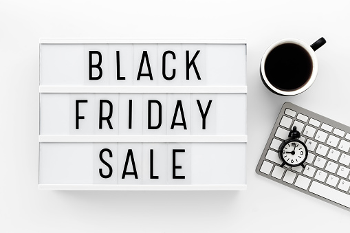 Black Friday sale sign blocks and keyboard and cup
