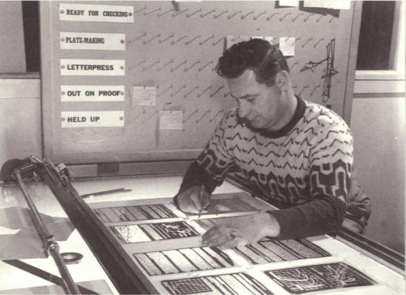 man working in print shop